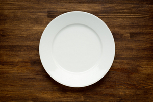 EMPTY WHITE PLATE ON WOODEN TABLE © Vladyslav Bashutskyy | Dreamstime.com